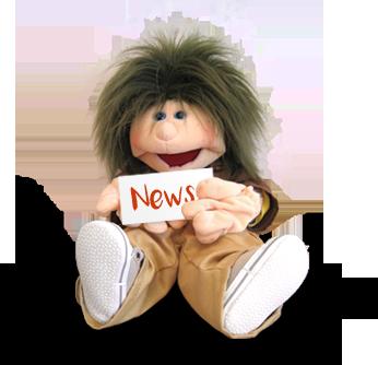 Puppe Malte mit Schild zu News und Aktuelles in den Händen Psychotherapeutische Praxis Bochum - Psychotherapie für Kinder und Jugendliche in Bochum von Diplom-Psychologin Susanne Kiessling